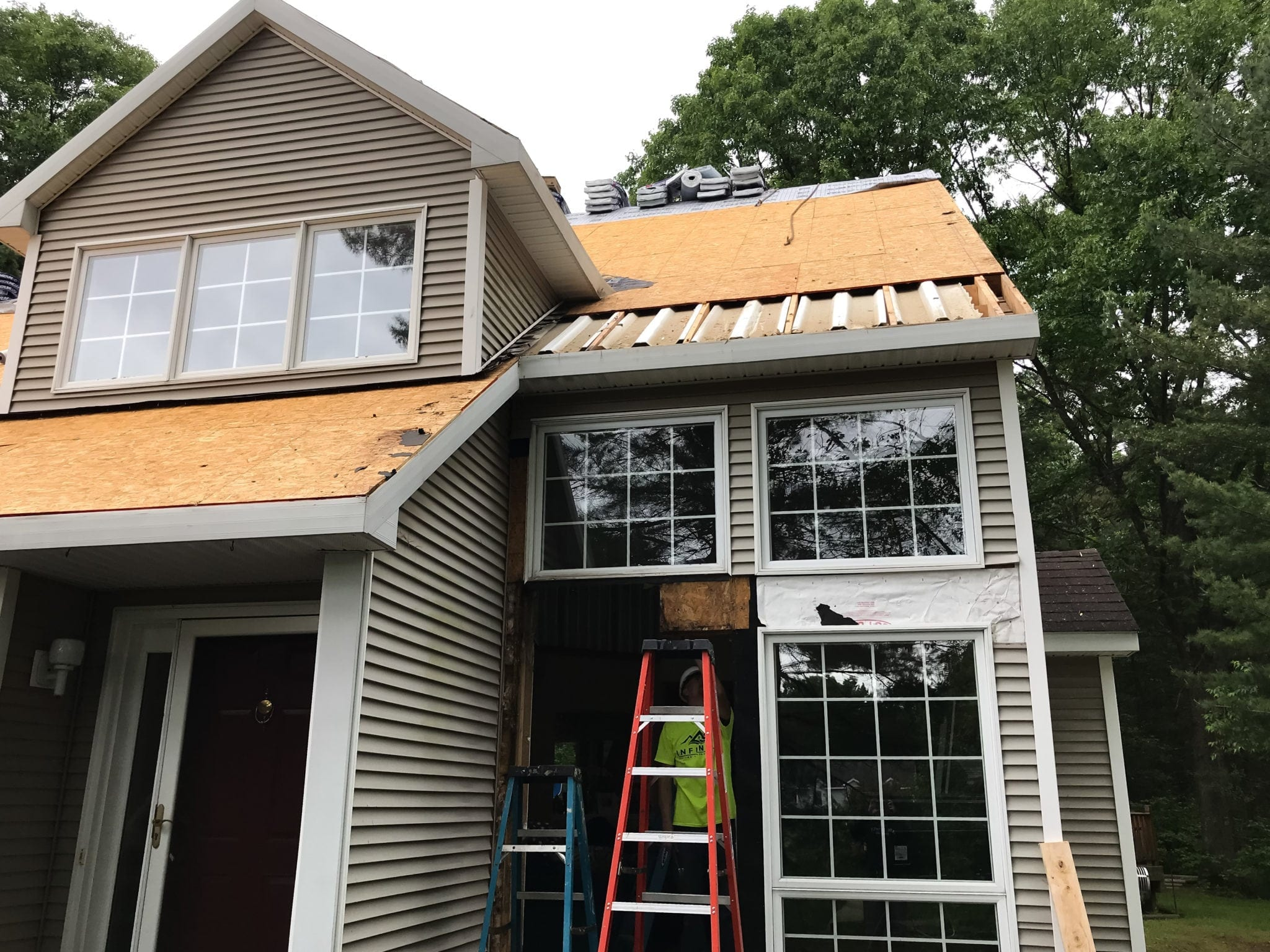 infinite roofing repairing roof damage
