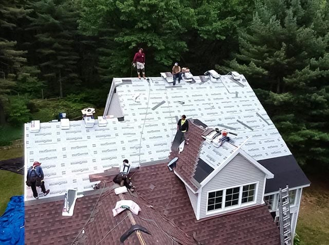 infinite crew working on roof